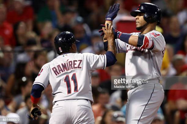 Edwin Encarnacion of the Cleveland Indians celebrates with Jose Ramirez after hitting a two run home run during the sixth inning against the Boston...