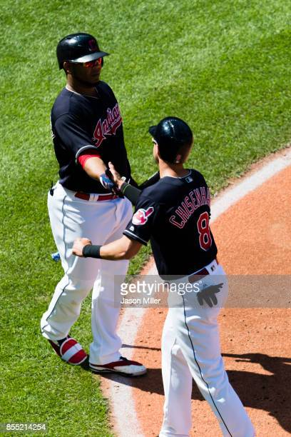 Edwin Encarnacion of the Cleveland Indians celebrates with Lonnie Chisenhall after Chisenhall scores during the fifth inning against the Baltimore...