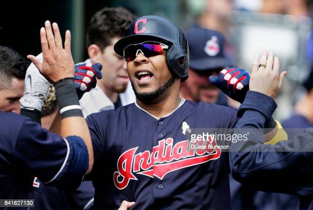 Edwin Encarnacion of the Cleveland Indians celebrates with teammates after hitting a solo home run against the Detroit Tigers during the sixth inning...