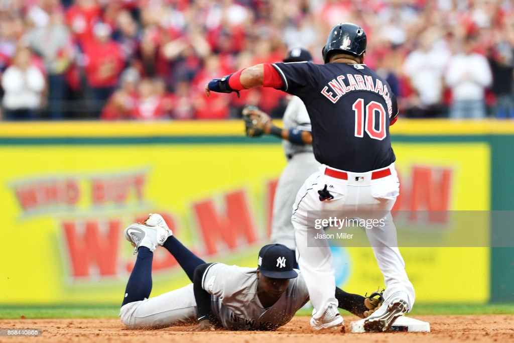 Edwin Encarnacion #10 of the Cleveland Indians is injured in the first inning against the New York Yankees during game two of the American League Division Series at Progressive Field on October 6, 2017 in Cleveland, Ohio.