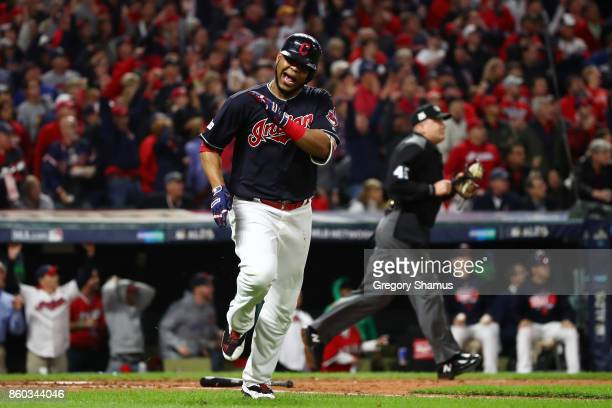 Edwin Encarnacion of the Cleveland Indians reacts after flying out to end the sixth inning against the New York Yankees in Game Five of the American...