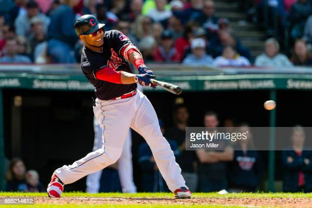 Edwin Encarnacion of the Cleveland Indians singles during the seventh inning against the Baltimore Orioles at Progressive Field on September 9 2017...