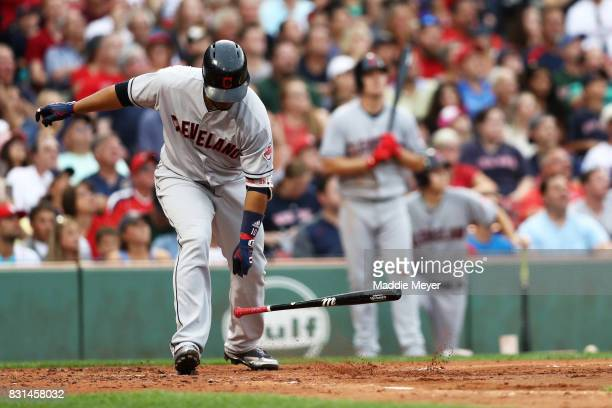 Edwin Encarnacion of the Cleveland Indians tosses hit bat after hitting a fly ball during the second inning against the Boston Red Sox at Fenway Park...