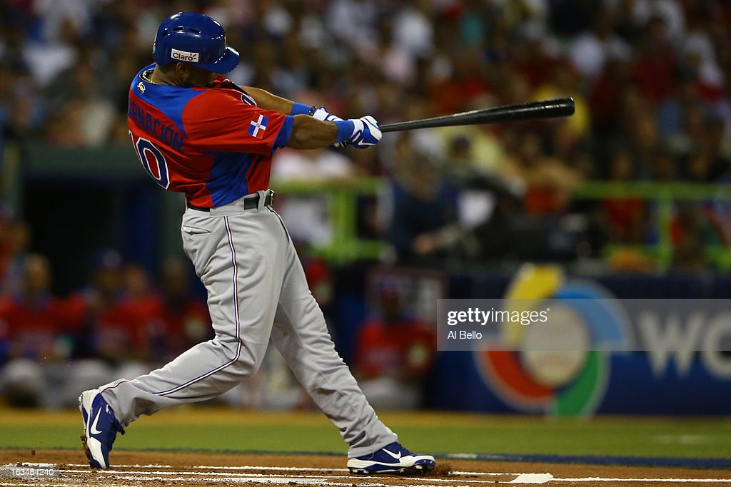 <a gi-track='captionPersonalityLinkClicked' href=/galleries/search?phrase=Edwin+Encarnacion&family=editorial&specificpeople=598285 ng-click='$event.stopPropagation()'>Edwin Encarnacion</a> #10 of the Dominican Republic drives in arun against Puerto Rico during the first round of the World Baseball Classic at Hiram Bithorn Stadium on March 10, 2013 in San Juan, Puerto Rico.