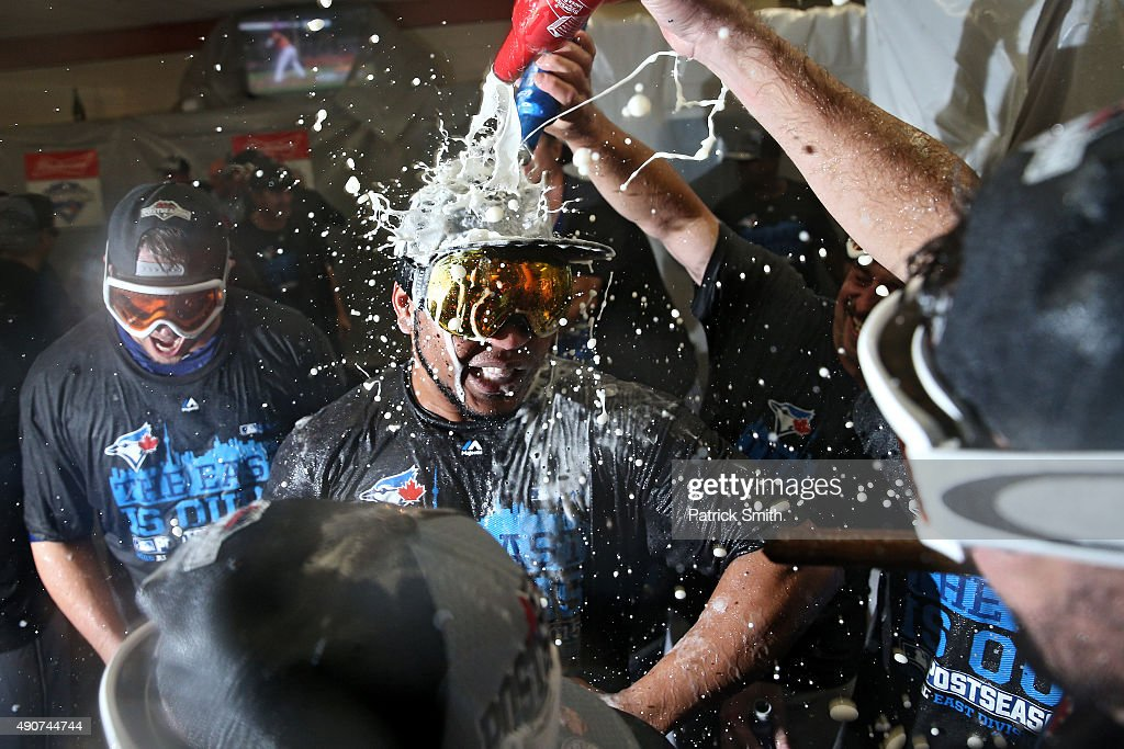 Edwin Encarnacion of the Toronto Blue Jays and teammates celebrate in the clubhouse after defeating the Baltimore Orioles and clinching the AL East...