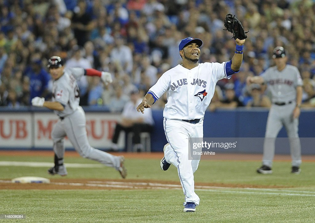 <a gi-track='captionPersonalityLinkClicked' href=/galleries/search?phrase=Edwin+Encarnacion&family=editorial&specificpeople=598285 ng-click='$event.stopPropagation()'>Edwin Encarnacion</a> #10 of the Toronto Blue Jays catches a pop-fly as <a gi-track='captionPersonalityLinkClicked' href=/galleries/search?phrase=Asdrubal+Cabrera&family=editorial&specificpeople=834042 ng-click='$event.stopPropagation()'>Asdrubal Cabrera</a> #13 of the Cleveland Indians rounds first base during MLB game action July 13, 2012 at Rogers Centre in Toronto, Ontario, Canada.