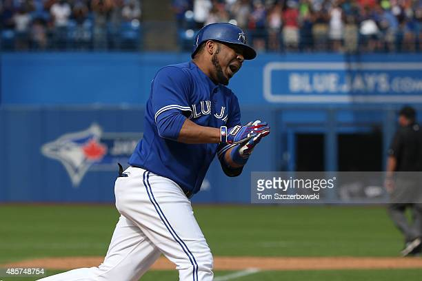 Edwin Encarnacion of the Toronto Blue Jays celebrates after hitting a grand slam home run in the seventh inning during MLB game action against the...