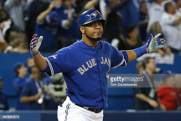 Edwin Encarnacion of the Toronto Blue Jays celebrates after hitting a sixth inning solo home run against the Texas Rangers in game five of the...