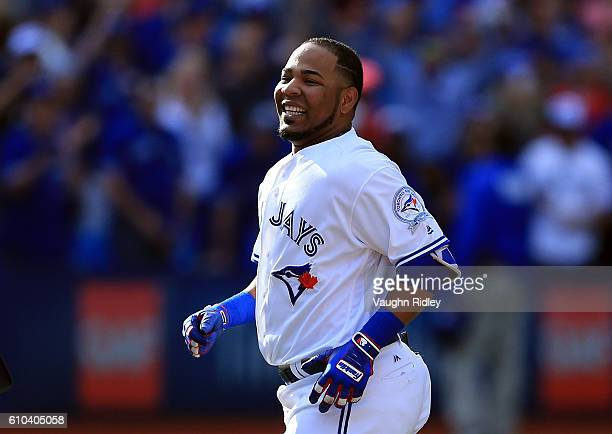Edwin Encarnacion of the Toronto Blue Jays celebrates after hitting a single where Kevin Pillar scored the winning run in the ninth inning during a...