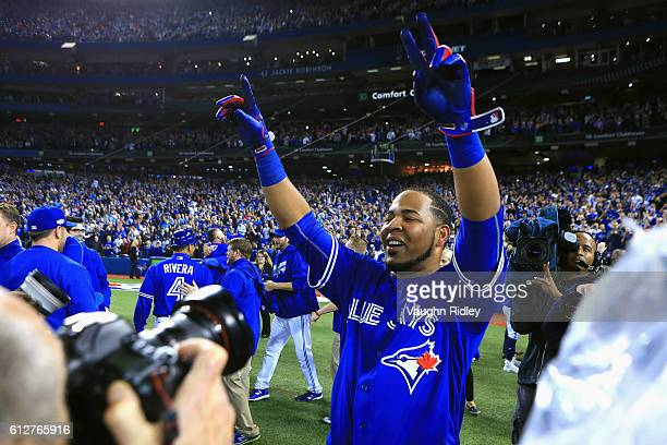 Edwin Encarnacion of the Toronto Blue Jays celebrates after hitting a threerun walkoff home run in the eleventh inning to defeat the Baltimore...