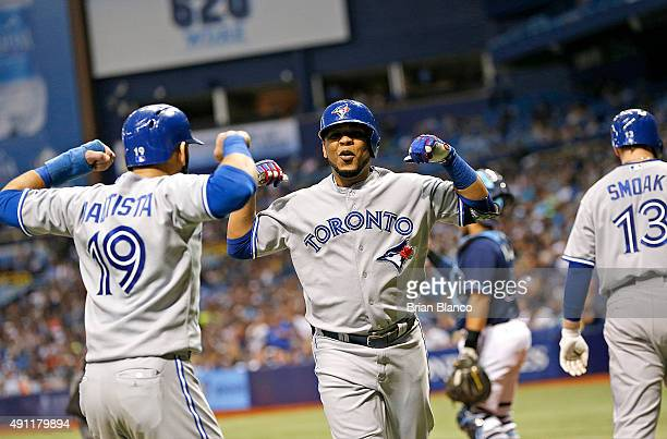 Edwin Encarnacion of the Toronto Blue Jays celebrates his tworun home run with teammate Jose Bautista during the sixth inning of a game against the...