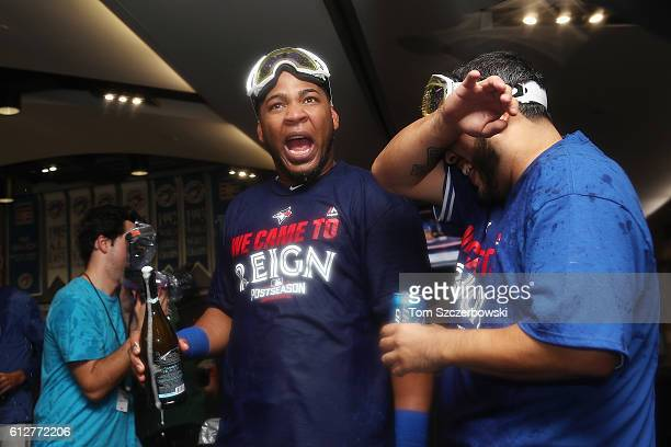 Edwin Encarnacion of the Toronto Blue Jays celebrates in the clubhouse after hitting a threerun walkoff home run in the eleventh inning to defeat the...