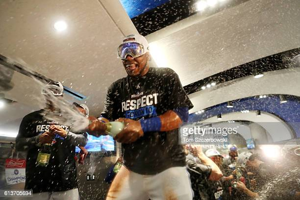 Edwin Encarnacion of the Toronto Blue Jays celebrates in the clubhouse after the Toronto Blue Jays defeated the Texas Rangers 76 for game three of...