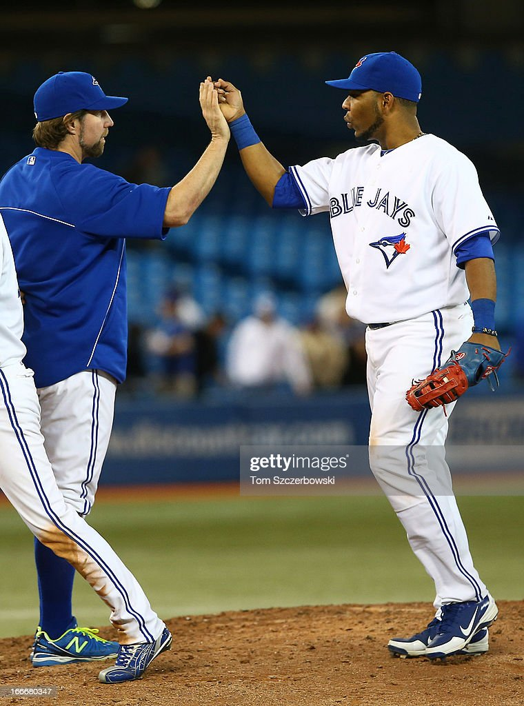 <a gi-track='captionPersonalityLinkClicked' href=/galleries/search?phrase=Edwin+Encarnacion&family=editorial&specificpeople=598285 ng-click='$event.stopPropagation()'>Edwin Encarnacion</a> (R) of the Toronto Blue Jays celebrates their win with <a gi-track='captionPersonalityLinkClicked' href=/galleries/search?phrase=R.A.+Dickey&family=editorial&specificpeople=221719 ng-click='$event.stopPropagation()'>R.A. Dickey</a> during MLB game action against the Chicago White Sox on April 15, 2013 at Rogers Centre in Toronto, Ontario, Canada. All uniformed team members are wearing jersey number 42 in honor of Jackie Robinson Day.