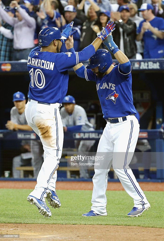 Edwin Encarnacion of the Toronto Blue Jays celebrates with Jose Bautista of the Toronto Blue Jays after they both score runs in the sixth inning...