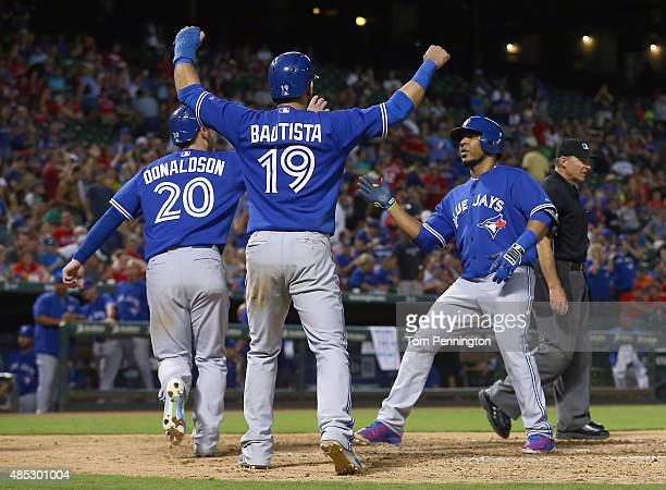 Edwin Encarnacion of the Toronto Blue Jays celebrates with Josh Donaldson of the Toronto Blue Jays and Jose Bautista of the Toronto Blue Jays after...