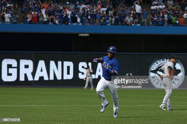 Edwin Encarnacion of the Toronto Blue Jays circles the bases after hitting a grand slam home run in the seventh inning during MLB game action against...