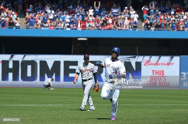 Edwin Encarnacion of the Toronto Blue Jays circles the bases after hitting a solo home run in the first inning during MLB game action against the...
