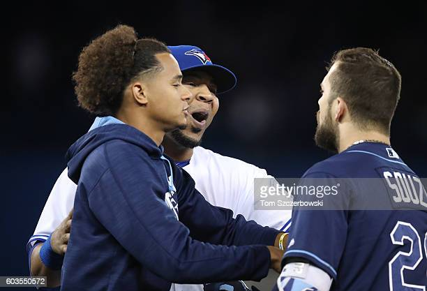 Edwin Encarnacion of the Toronto Blue Jays confronts Steven Souza Jr #20 of the Tampa Bay Rays as Chris Archer intervenes to restrain Souza after the...
