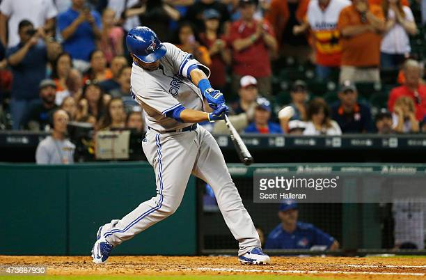 Edwin Encarnacion of the Toronto Blue Jays connects on a tworun home run in the ninth inning during their game against the Houston Astros at Minute...