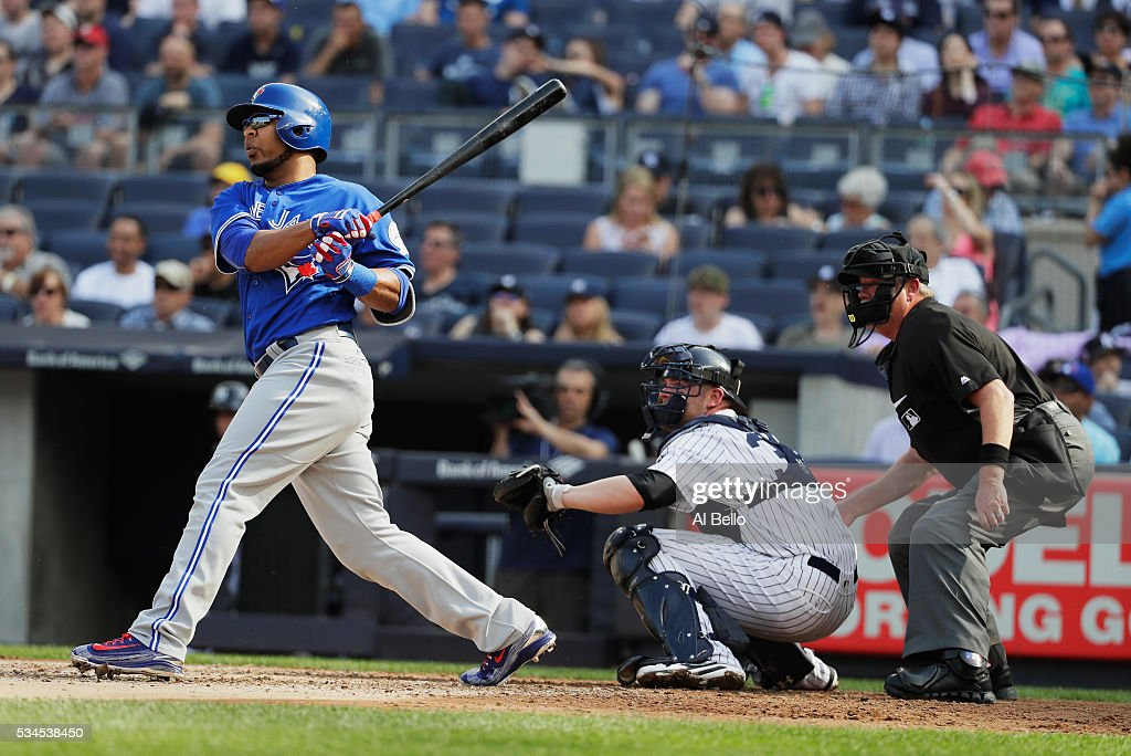 <a gi-track='captionPersonalityLinkClicked' href=/galleries/search?phrase=Edwin+Encarnacion&family=editorial&specificpeople=598285 ng-click='$event.stopPropagation()'>Edwin Encarnacion</a> #10 of the Toronto Blue Jays drives in two runs in the third inning against the New York Yankees during their game at Yankee Stadium on May 26, 2016 in New York City.