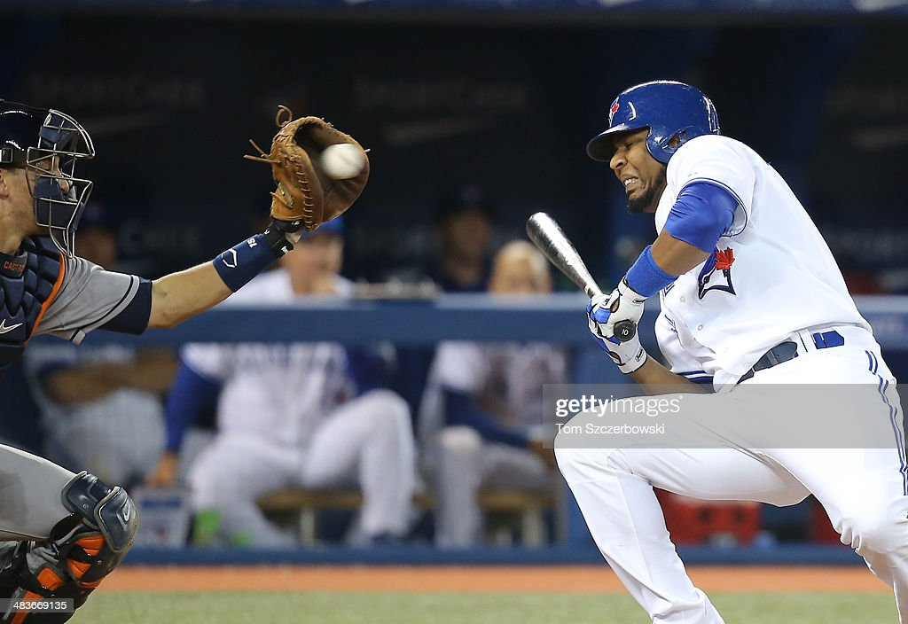Edwin Encarnacion #10 of the Toronto Blue Jays gets out of the way of an inside pitch in the sixth inning during MLB game action as Jason Castro #15 of the Houston Astros reaches for the ball on April 9, 2014 at Rogers Centre in Toronto, Ontario, Canada.