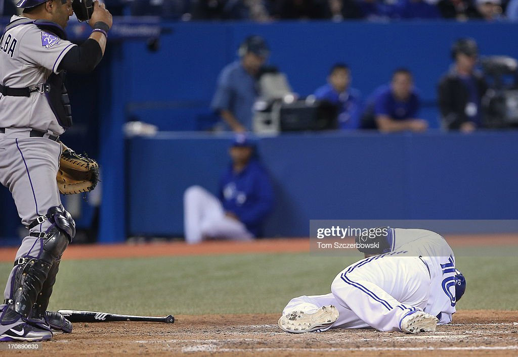 <a gi-track='captionPersonalityLinkClicked' href=/galleries/search?phrase=Edwin+Encarnacion&family=editorial&specificpeople=598285 ng-click='$event.stopPropagation()'>Edwin Encarnacion</a> #10 of the Toronto Blue Jays goes down after being hit by the pitch in the seventh inning during MLB game action as <a gi-track='captionPersonalityLinkClicked' href=/galleries/search?phrase=Yorvit+Torrealba&family=editorial&specificpeople=212721 ng-click='$event.stopPropagation()'>Yorvit Torrealba</a> #8 of the Colorado Rockies looks on on June 19, 2013 at Rogers Centre in Toronto, Ontario, Canada.