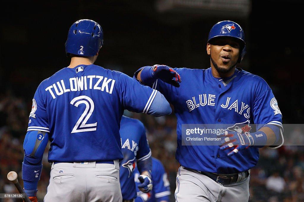 Edwin Encarnacion of the Toronto Blue Jays high fives Troy Tulowitzki after Encarnacion hit a two run home run against the Arizona Diamondbacks...
