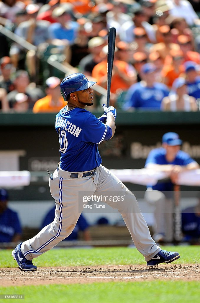 Edwin Encarnacion #10 of the Toronto Blue Jays hits a single in the eighth inning against the Baltimore Orioles at Oriole Park at Camden Yards on July 14, 2013 in Baltimore, Maryland.