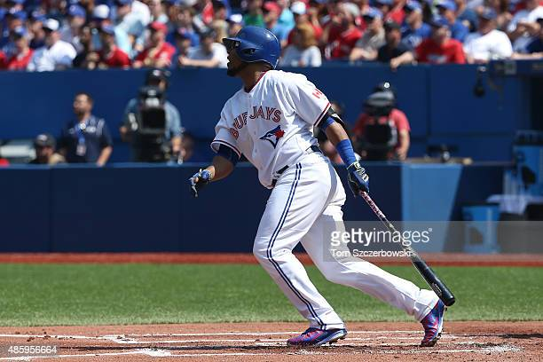 Edwin Encarnacion of the Toronto Blue Jays hits a solo home run in the first inning during MLB game action against the Detroit Tigers on August 30...