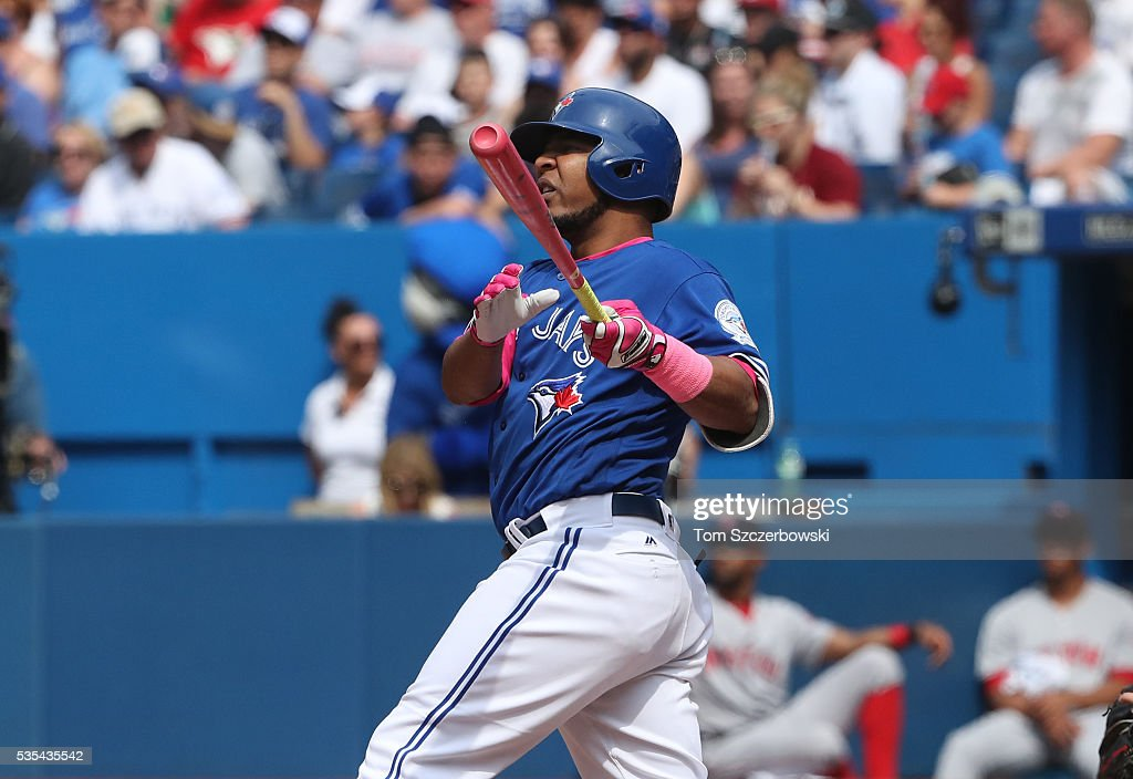 Edwin Encarnacion #10 of the Toronto Blue Jays hits a solo home run in the eighth inning to tie the game during MLB game action against the Boston Red Sox on May 29, 2016 at Rogers Centre in Toronto, Ontario, Canada.