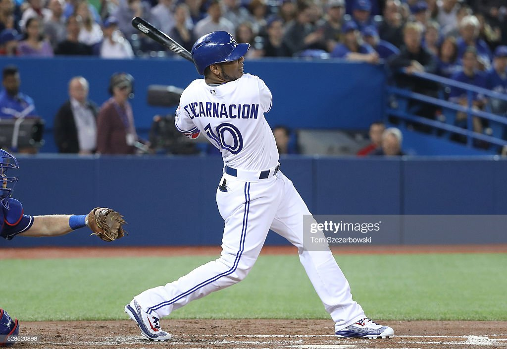 Edwin Encarnacion #10 of the Toronto Blue Jays hits a three-run double in the first inning during MLB game action against the Texas Rangers on May 5, 2016 at Rogers Centre in Toronto, Ontario, Canada.