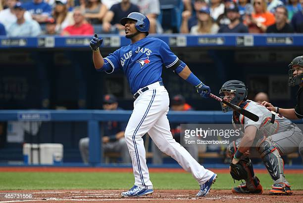 Edwin Encarnacion of the Toronto Blue Jays hits a threerun home run in the first inning during MLB game action against the Detroit Tigers on August...