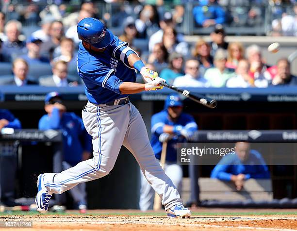 Edwin Encarnacion of the Toronto Blue Jays hits a two run homer in the third inning against the New York Yankees during Opening Day on April 6 2015...