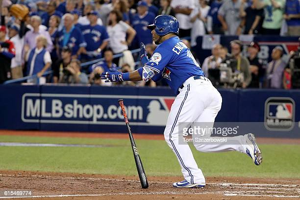 Edwin Encarnacion of the Toronto Blue Jays hits an RBI double scoring Ryan Goins and Jose Bautista in the seventh inning against Bryan Shaw of the...
