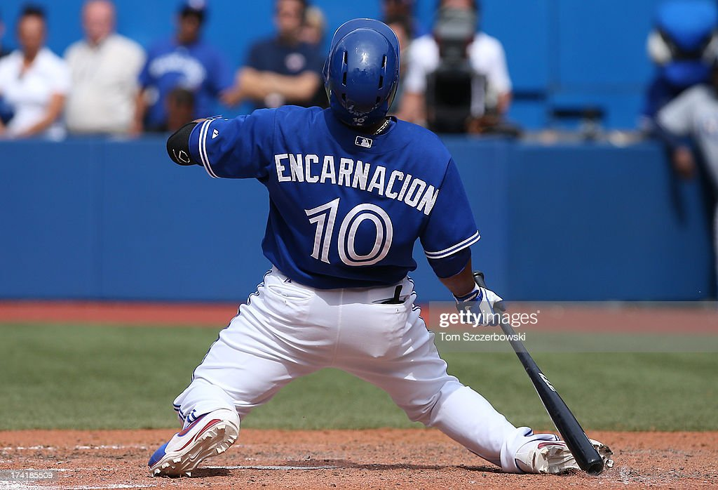 <a gi-track='captionPersonalityLinkClicked' href=/galleries/search?phrase=Edwin+Encarnacion&family=editorial&specificpeople=598285 ng-click='$event.stopPropagation()'>Edwin Encarnacion</a> #10 of the Toronto Blue Jays is brushed back by an inside pitch in the ninth inning during MLB game action against the Tampa Bay Rays on July 21, 2013 at Rogers Centre in Toronto, Ontario, Canada.