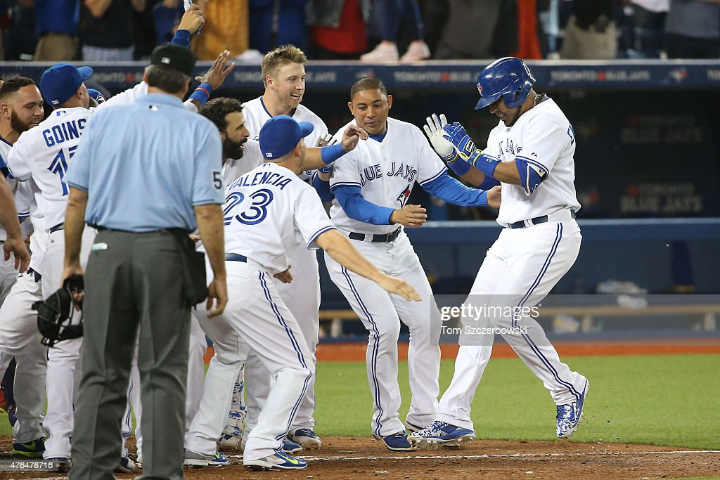<a gi-track='captionPersonalityLinkClicked' href=/galleries/search?phrase=Edwin+Encarnacion&family=editorial&specificpeople=598285 ng-click='$event.stopPropagation()'>Edwin Encarnacion</a> #10 of the Toronto Blue Jays is congratulated by teammates after hitting a game-winning two-run home run in the ninth inning during MLB game action against the Miami Marlins on June 9, 2015 at Rogers Centre in Toronto, Ontario, Canada.