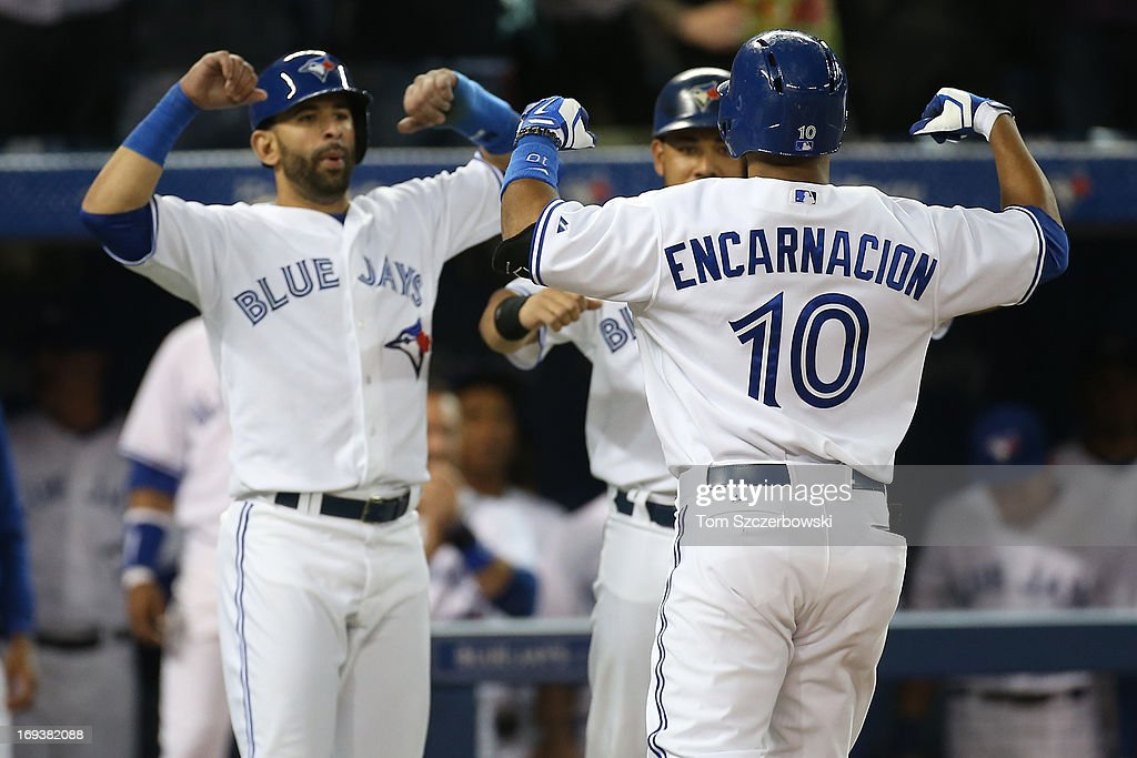 Edwin Encarnacion #10 of the Toronto Blue Jays is congratulated by Jose Bautista #19 and <a gi-track='captionPersonalityLinkClicked' href=/galleries/search?phrase=Melky+Cabrera&family=editorial&specificpeople=453444 ng-click='$event.stopPropagation()'>Melky Cabrera</a> #53 after hitting a grand slam home run in the sixth inning during MLB game action against the Baltimore Orioles on May 23, 2013 at Rogers Centre in Toronto, Ontario, Canada.