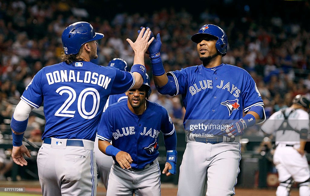 Edwin Encarnacion of the Toronto Blue Jays is congratulated by teammate Josh Donaldson after hitting a threerun home run against the Arizona...