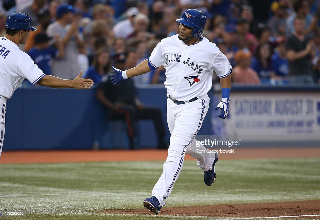 <a gi-track='captionPersonalityLinkClicked' href=/galleries/search?phrase=Edwin+Encarnacion&family=editorial&specificpeople=598285 ng-click='$event.stopPropagation()'>Edwin Encarnacion</a> #10 of the Toronto Blue Jays is congratulated by third base coach Luis Rivera #2 after hitting a two-run home run in the second inning during MLB game action against the New York Yankees on August 28, 2013 at Rogers Centre in Toronto, Ontario, Canada.