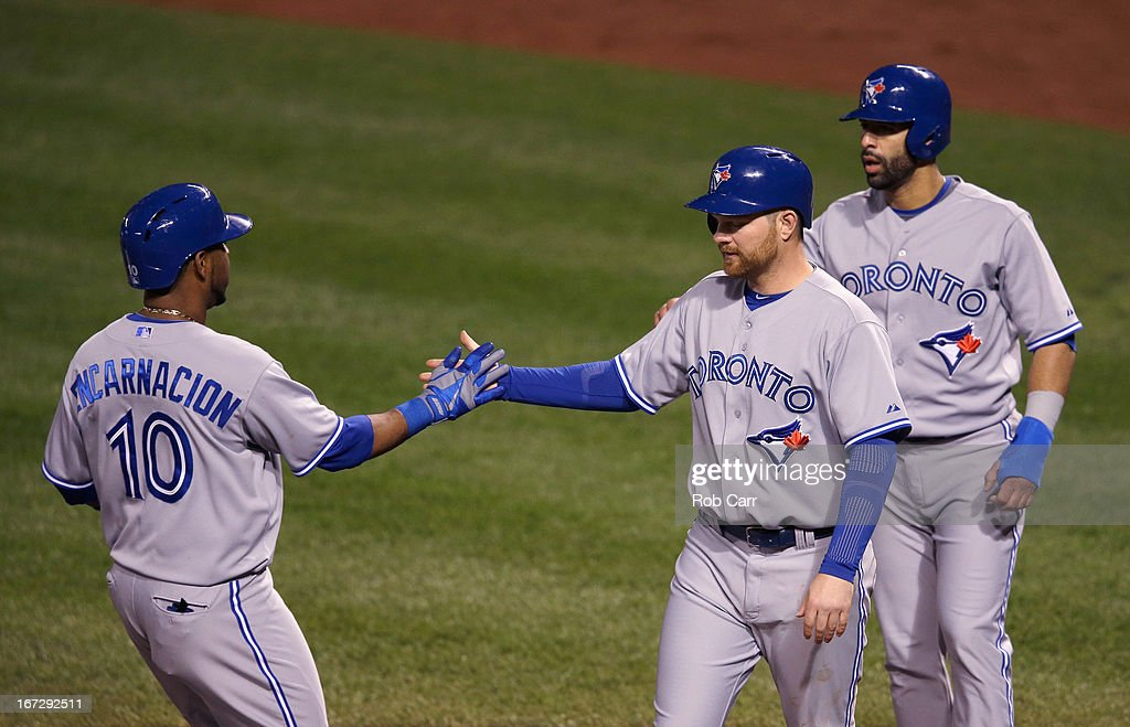 Edwin Encarnacion #10 of the Toronto Blue Jays is greeted at the plate after hitting a three RBI home run to drive in teammates <a gi-track='captionPersonalityLinkClicked' href=/galleries/search?phrase=Adam+Lind&family=editorial&specificpeople=3911783 ng-click='$event.stopPropagation()'>Adam Lind</a> #26 (C) and Jose Bautista #19 (R) during the sixth inning against the Baltimore Orioles at Oriole Park at Camden Yards on April 23, 2013 in Baltimore, Maryland. The Orioles won 4-3.