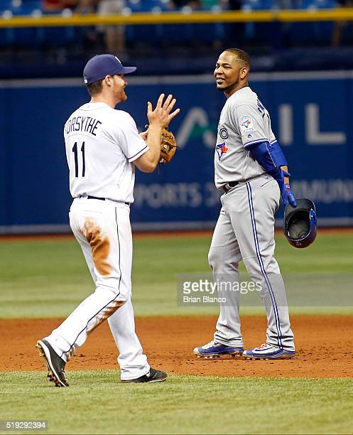 Edwin Encarnacion of the Toronto Blue Jays looks on as Logan Forsythe of the Tampa Bay Rays celebrates after Encarnacion grounded into the double...