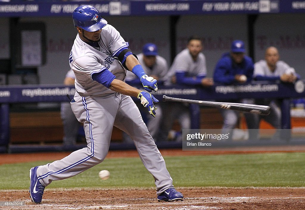 <a gi-track='captionPersonalityLinkClicked' href=/galleries/search?phrase=Edwin+Encarnacion&family=editorial&specificpeople=598285 ng-click='$event.stopPropagation()'>Edwin Encarnacion</a> #10 of the Toronto Blue Jays loses his bat during during the seventh inning of a game against the Tampa Bay Rays on September 2, 2014 at Tropicana Field in St. Petersburg, Florida.
