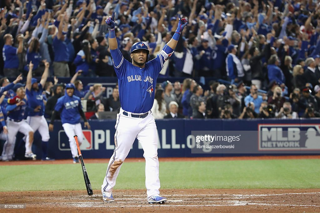 Edwin Encarnacion #10 of the Toronto Blue Jays reacts after hitting a three-run walk-off home run in the eleventh inning to defeat the Baltimore Orioles 5-2 in the American League Wild Card game at Rogers Centre on October 4, 2016 in Toronto, Canada.