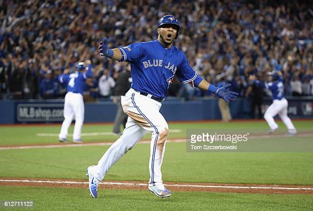 Edwin Encarnacion of the Toronto Blue Jays reacts after hitting a threerun walkoff home run in the eleventh inning to defeat the Baltimore Orioles 52...