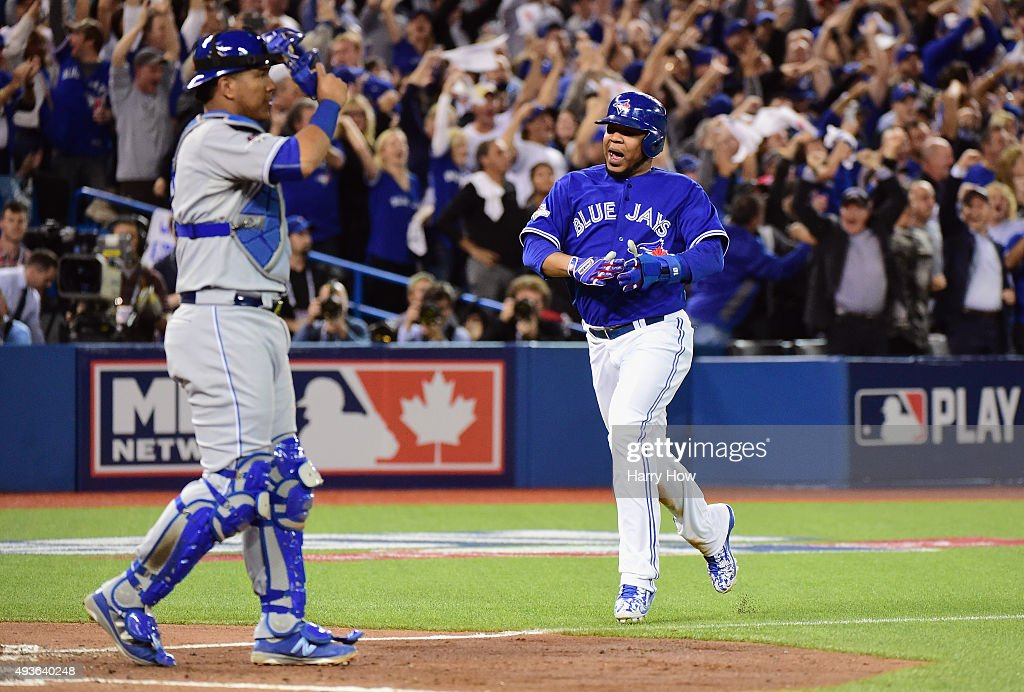 <a gi-track='captionPersonalityLinkClicked' href=/galleries/search?phrase=Edwin+Encarnacion&family=editorial&specificpeople=598285 ng-click='$event.stopPropagation()'>Edwin Encarnacion</a> #10 of the Toronto Blue Jays reacts as he scores a run in the sixth inning against the Kansas City Royals during game five of the American League Championship Series at Rogers Centre on October 21, 2015 in Toronto, Canada.
