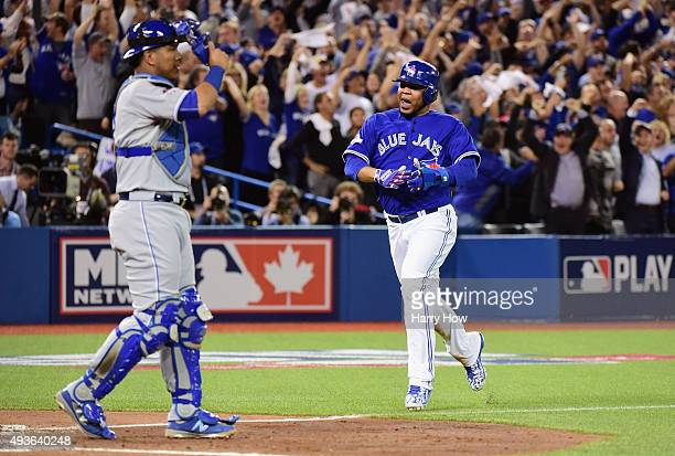 Edwin Encarnacion of the Toronto Blue Jays reacts as he scores a run in the sixth inning against the Kansas City Royals during game five of the...
