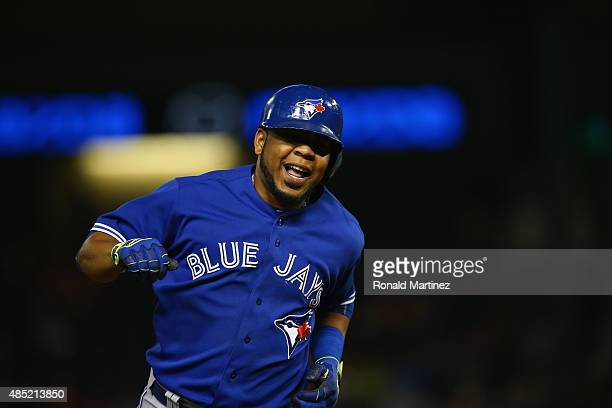Edwin Encarnacion of the Toronto Blue Jays runs the bases on a home run in the sixth inning against the Texas Rangers at Globe Life Park in Arlington...