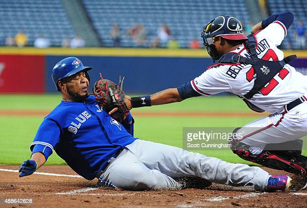 Edwin Encarnacion of the Toronto Blue Jays scores a first inning run against Christian Bethancourt of the Atlanta Braves at Turner Field on September...