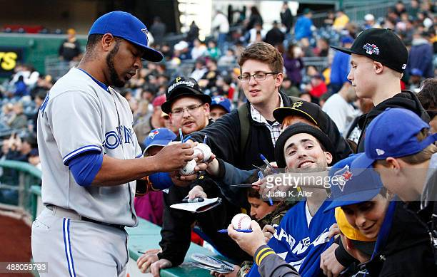 Edwin Encarnacion of the Toronto Blue Jays signs autographs before the game against the Pittsburgh Pirates at PNC Park May 3 2014 in Pittsburgh...